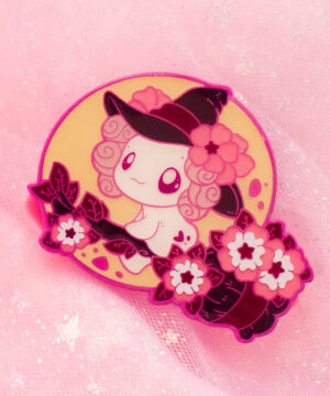 A color-dyed enamel pin featuring Lottie the Lotl