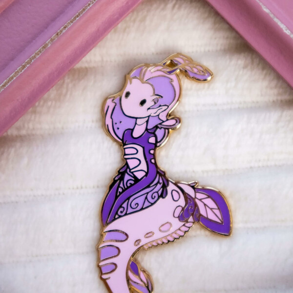 """Gold plated """"weedy sea dragon"""" enamel pin doll with dangle tail and raised metal outlines."""