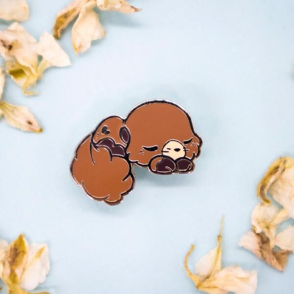 Cute baby sea otter hard enamel pin by Evy Benita
