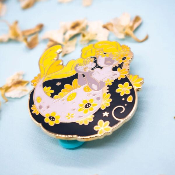 Vibrant yellow fantasy mermaid enamel pin by Evy Benita.