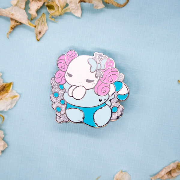 "Festive ""Lottie the Lotl"" chibi axolotl holiday stocking enamel pin with silver and glitter"