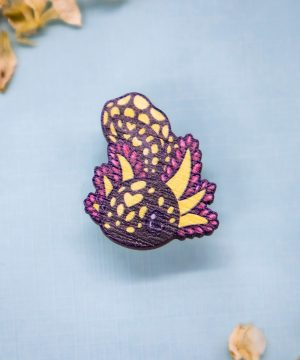 "Yellow mole salamander ""axolotl"" sustainably sourced wooden pin by Evy Benita."