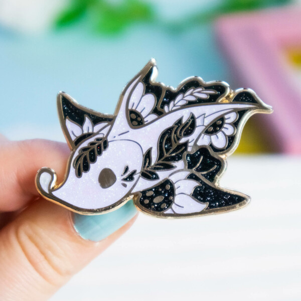 """Rare Chimaera """"Ghost Shark"""" hard enamel pin made with gold plating and iridescent glitter. Design by Evy Benita."""