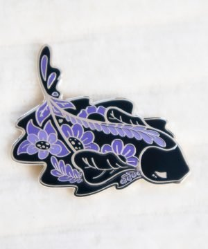 Stunning Creature Vault black ghost knifefish pin badge made with hard enamel and silver plating. Design by Evy Benita.