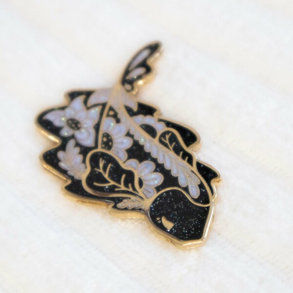 Ghost knife fish enamel pin made with iridescent glitter and hard enamel. Design by Evy Benita.