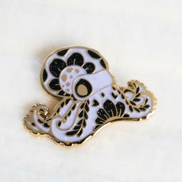 Cute ghost octopus hard enamel pin with gold plating and iridescent glitter.