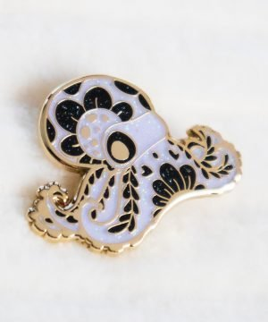 Floral ghost octopus hard enamel pin with gold plating and iridescent glitter.