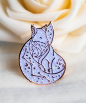 Rose gold Arctic Fox hard enamel pin with iridescent glitter and decorative constellation pattern. Design by Evy Benita.