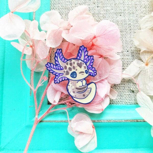 "Cute purple mole salamander ""axolotl"" sustainably sourced wooden pin by Evy Benita."