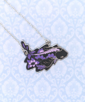 A lovely floral necklace pendant featuring a stylized black ghost knifefish