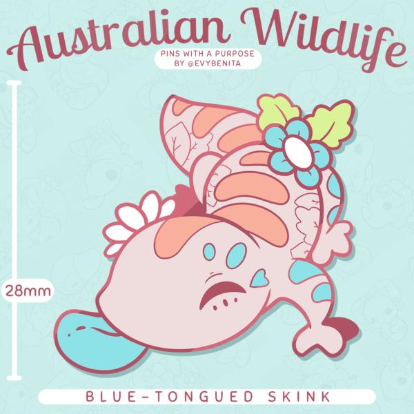 A cute chibi lizard enamel pin featuring the blue-tongued skink: an Australian reptile species.