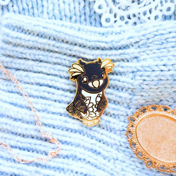 Macaroni Penguin hard enamel pin by Evy Benita