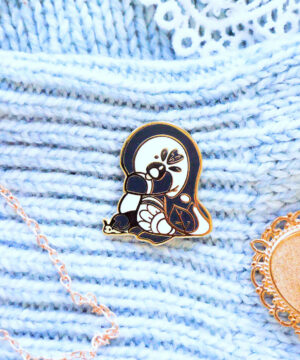 """A cute kawaii hard enamel pin of a """"Magellanic""""-type penguin. Designed by Evy Benita in a cartoon-style aesthetic. Perfect gift for enamel pin collectors!"""