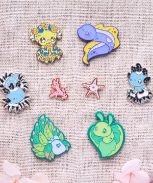 Showing the full set of Reef City Sidekicks plus two board filler pins: a total of eight enamel pins.