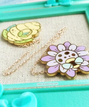 Cute bee hive and flower enamel pin set by Evy Benita