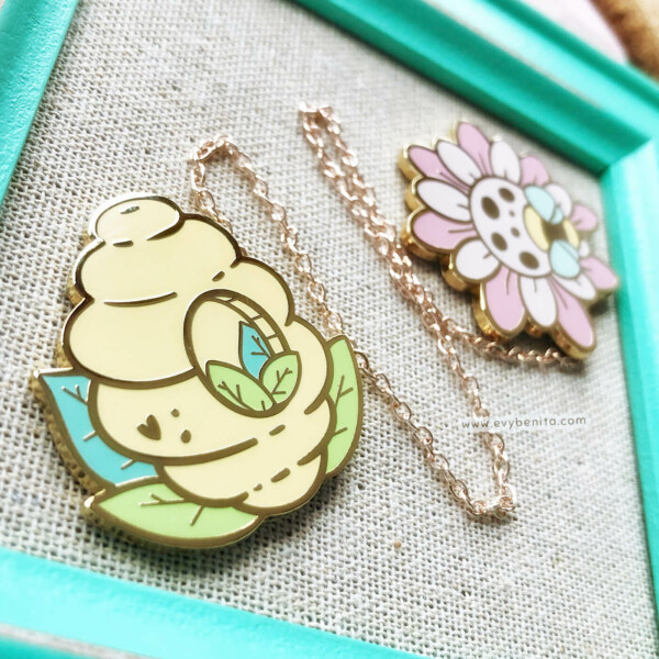 Cute bee hive and flower enamel pin set by Evy Benita