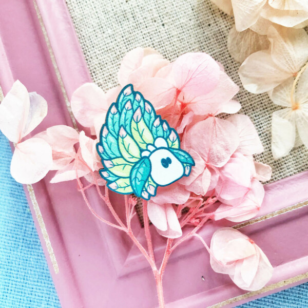 Cute Costasiella Kuroshimae sea slug wooden pin illustrated by Evy Benita.