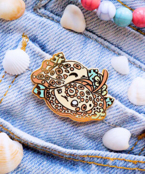 An adorable stingray enamel pin designed by Evy Benita, and featuring the Ocellate River Ray.