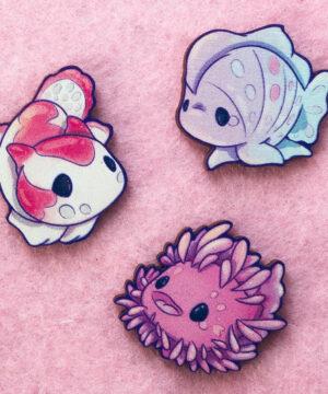 Kawaii frogfish wooden pins illustrated by Evy Benita