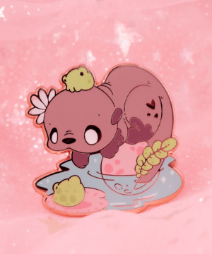 Kawaii southern river otter enamel pin with cute frogs. Designed by Evy Benita