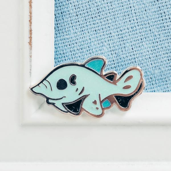 Sparkly goblin shark hard enamel pin by Evy Benita