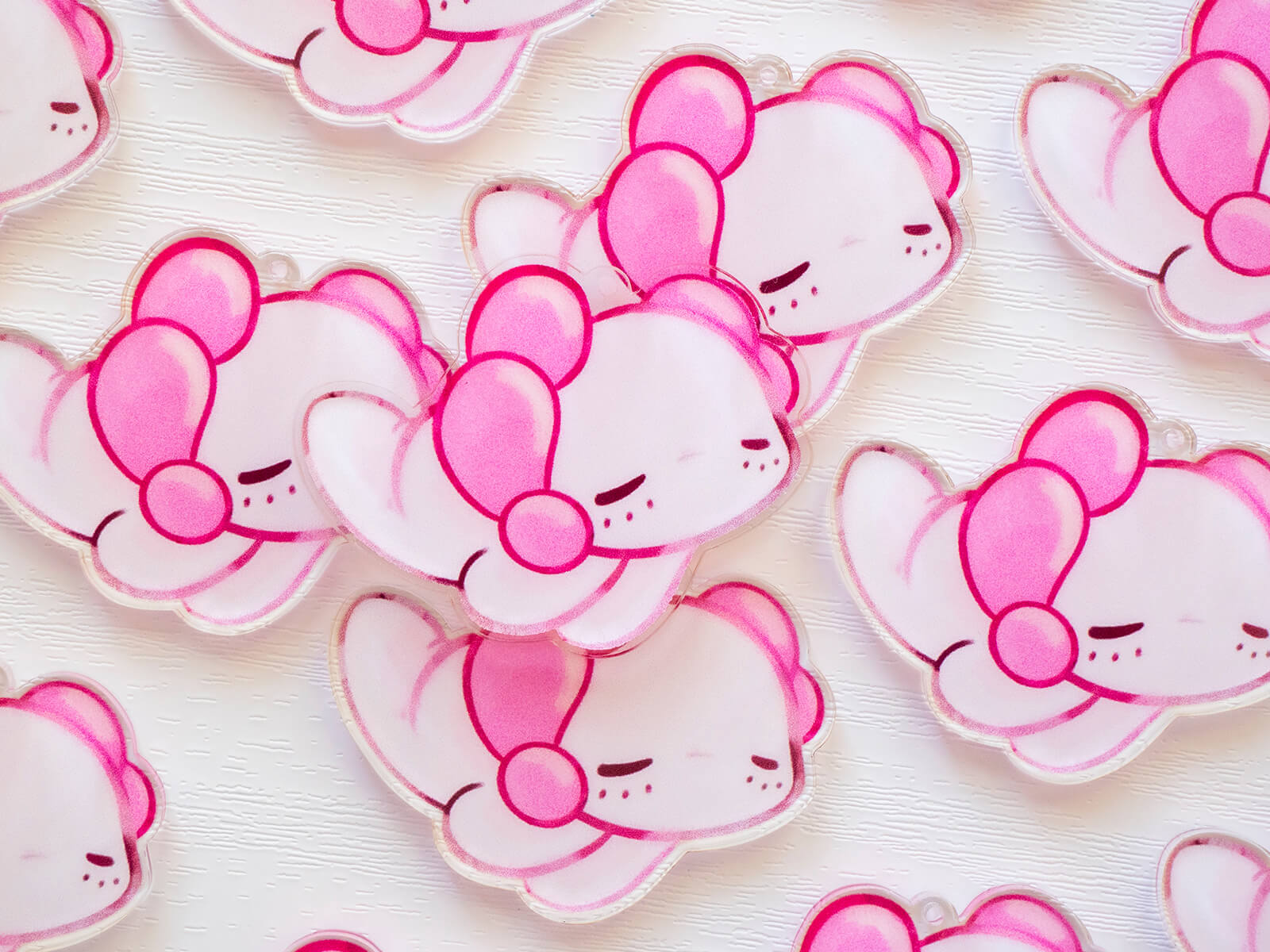 Pink kawaii charms featuring Lottie the axolotl