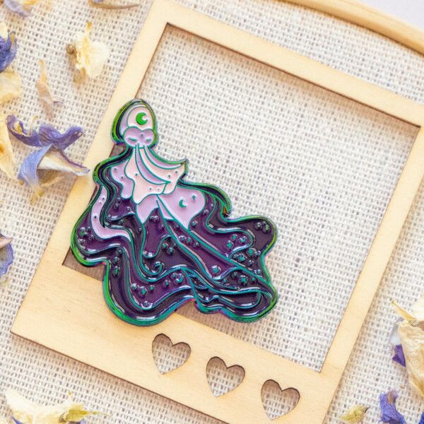 Rainbow blanket octopus enamel pin. Made with rainbow metal and soft enamel, and decorated with cosmic stars and shimmer symbols.